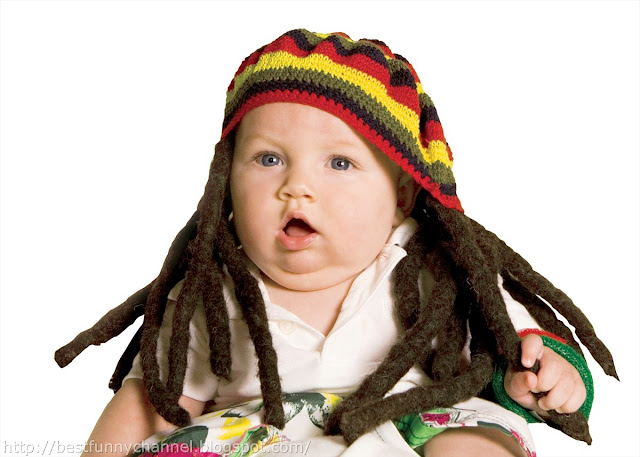 Funny kid with dreadlocks.