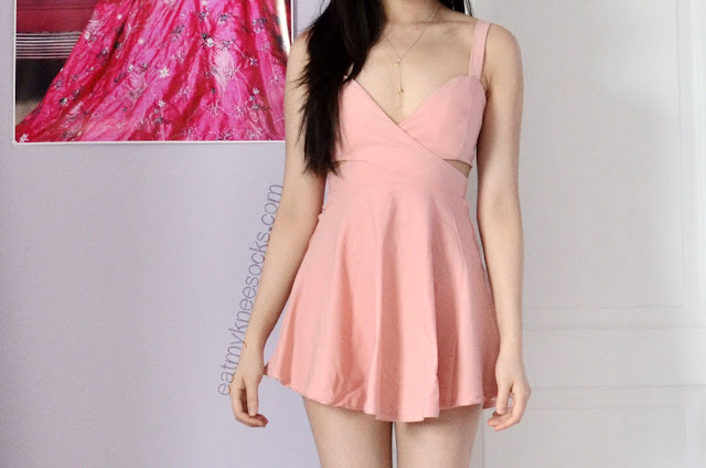 The pink cutout spaghetti-strap skater dress from Romwe is perfect for spring and summer, with a deep neckline, flared skirt, and side cutouts.