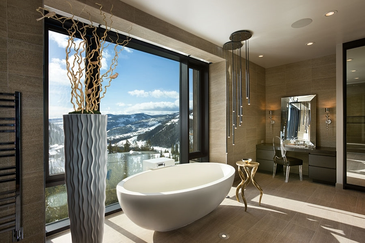 Bathtub by the window in Elegant Mountain Home by Reid Smith Architects