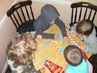 children completing a map of the world jigsaw