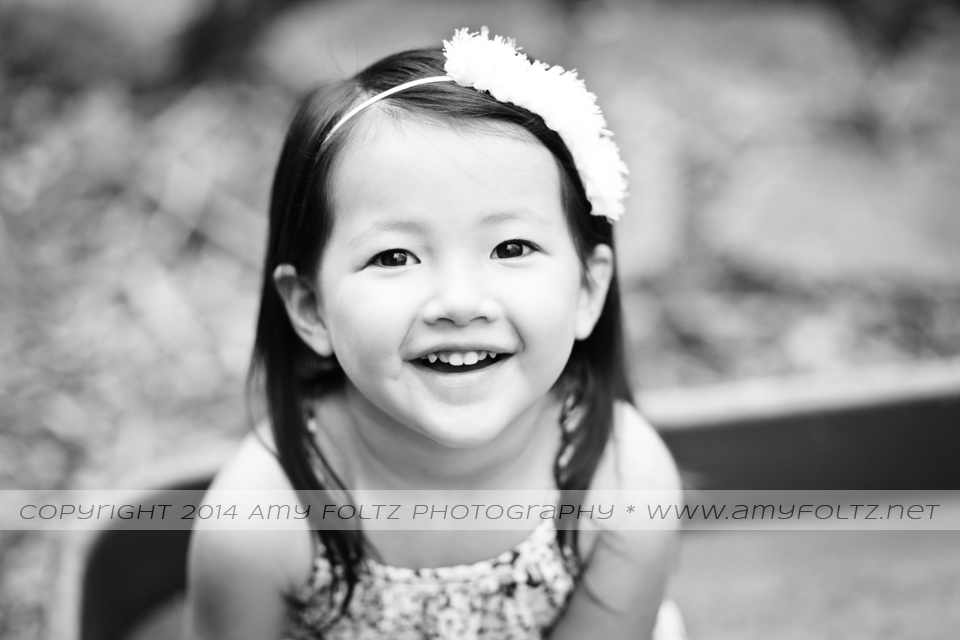 black and white portrait of toddler girl smiling