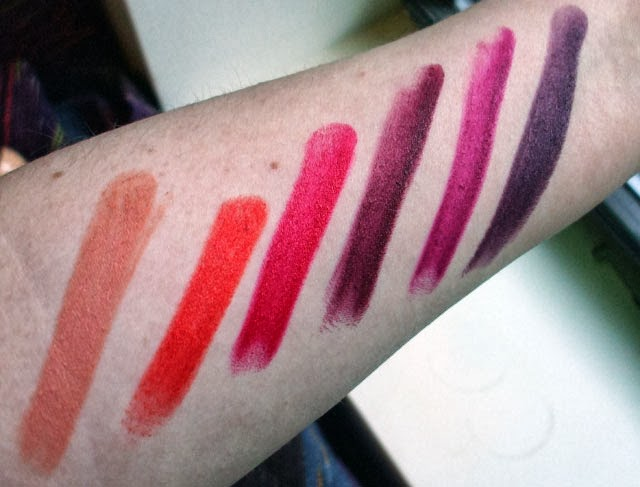 Wet n Wild Mega Last Lip Color inPurty Persimmon 970 Vamp It Up 919B Sugar Plum Fairy 908C Stoplight Red 911D Cherry Bomb 918D Pink Suga' 900B swatches