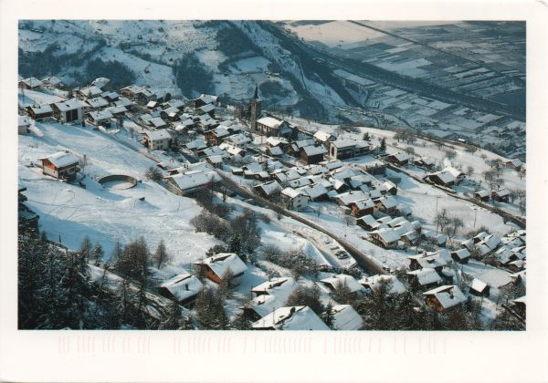aerial view of ski resort under snow