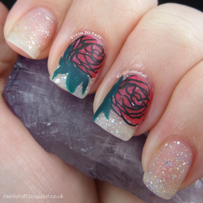 Romantic and sparkly nail art featuring roses and diamond glitter, matted.