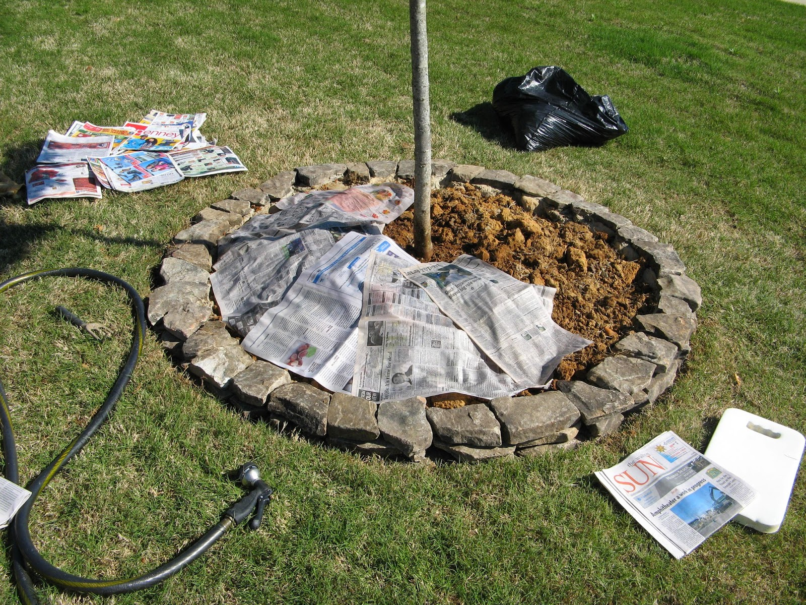 DIY Stacked Stone Landscape Border - newsprint as landscaping cloth