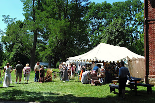 many people on the lawn at locust grove during the jane austen festival with a tent with gift ware