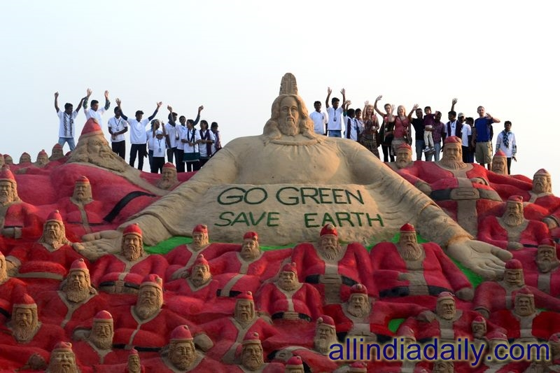 "500 of sand Santa clauses spreading messages about Global Warming with a slogan ""Go Green Save Earth "" on 10th sand art festival from 22nd December to 1st jan at behind Panthanivas hotel, Puri, Odisha"