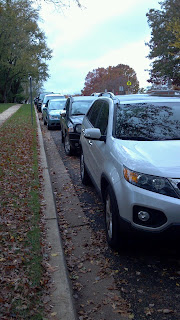 successive cars parked poorly in parallel fashion
