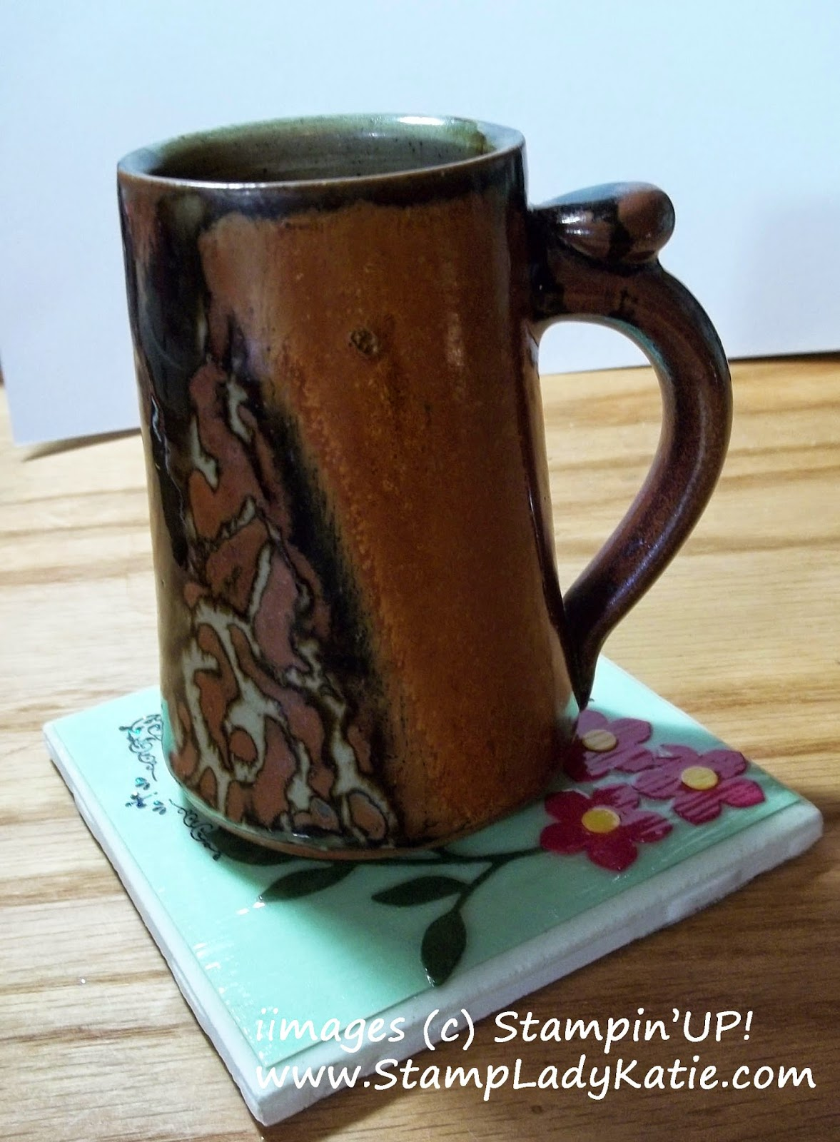 Coffee Cup on a Tile Coaster made with a punch art flower and Modge Podge Finish