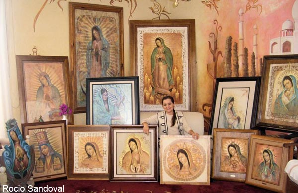 Artist Rocio Sandoval with her paintings of the Virgin of Guadalupe