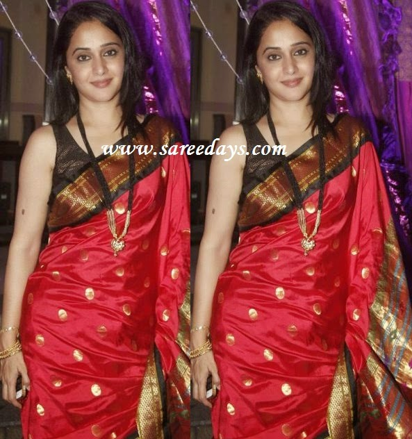 Latest saree designs red kanchipuram silk saree checkout red kanchipuram silk saree with zari work and black zari border and paired with matching sleeveless blouse altavistaventures Image collections