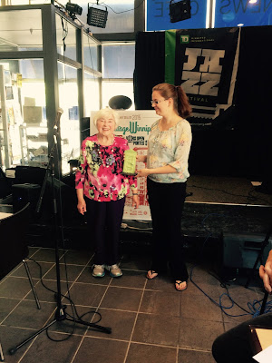 Heritage Winnipeg Summer Student, Laura McKay, presents the award to Dr. Mary Pankiw, Parish Secretary of Holy Ghost.