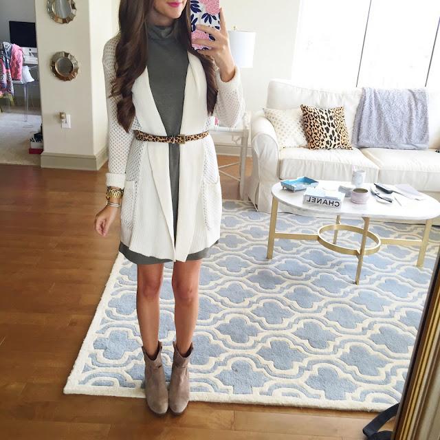 Wear a cardigan over a sleeveless turtleneck dress