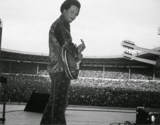 Caleb Quaye at Wembley stadium 1975 with Elton John band
