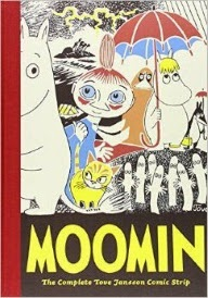 Cover of Moomin Volume One, featuring an assortment of people on a seashore. Two of them look like upright hippopotamuses.