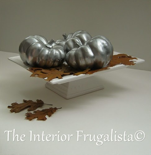Spray painted plastic pumpkins with metallic reflective paint