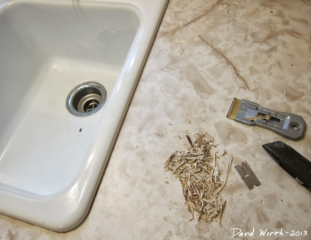 fixing a damaged sink, remove, caulk