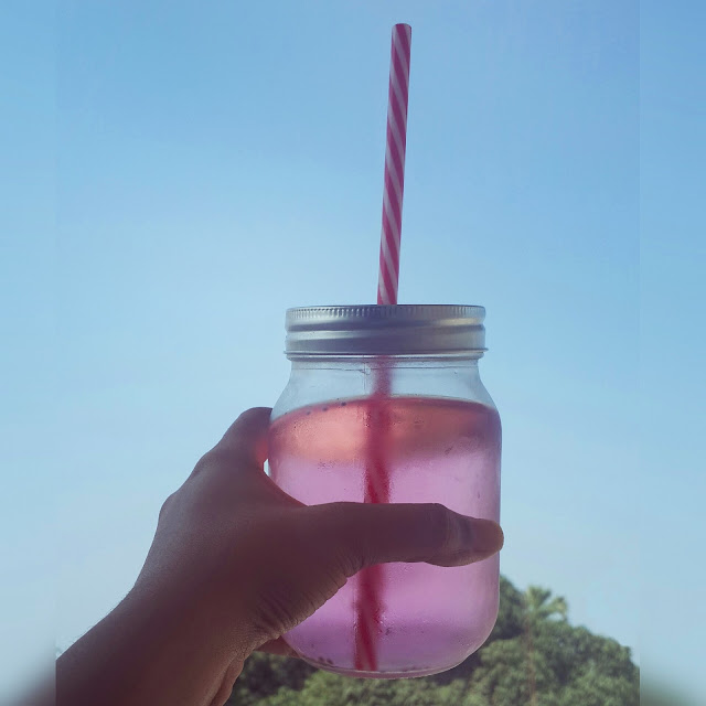 Humid summer afternoon with a mason jar filled with rose water and chia seeds as a beverage