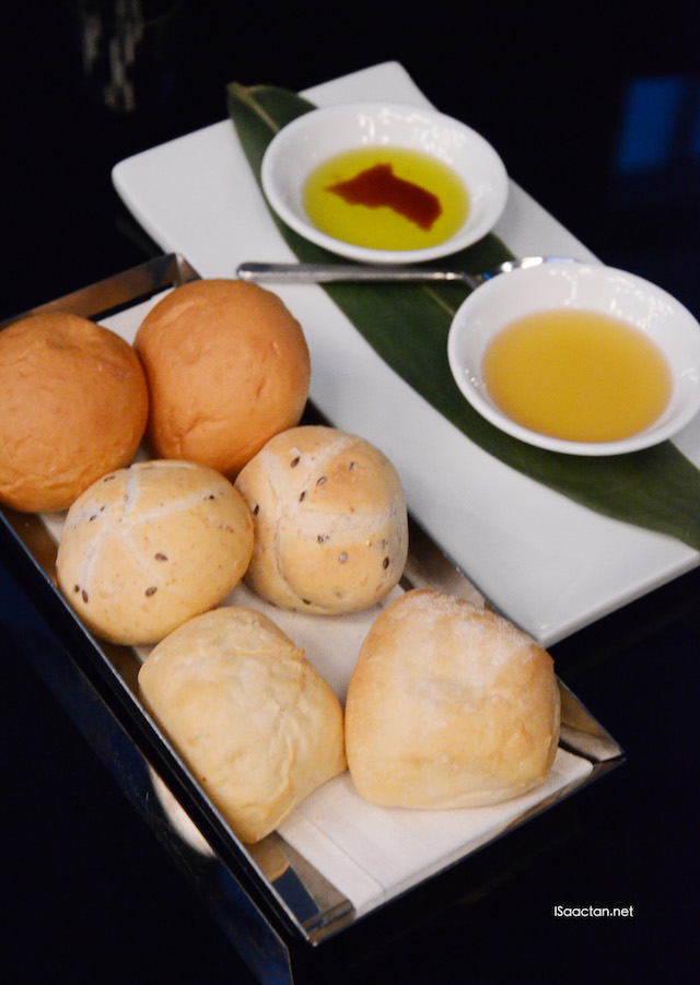 Assorted Bread Rolls with walnut oil and balsamic pomegranate vinaigrette