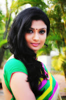Ishitha in saree cute stills from movie Miss Leelavathi a remake of Malyalam movie