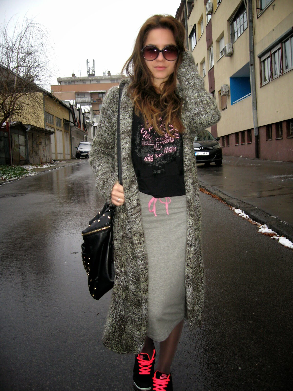 outfit, long cardigan, printed sweatshirt, grey pencil skirt, nike free run black and pink, carpisa black studded bag, round sunglasses