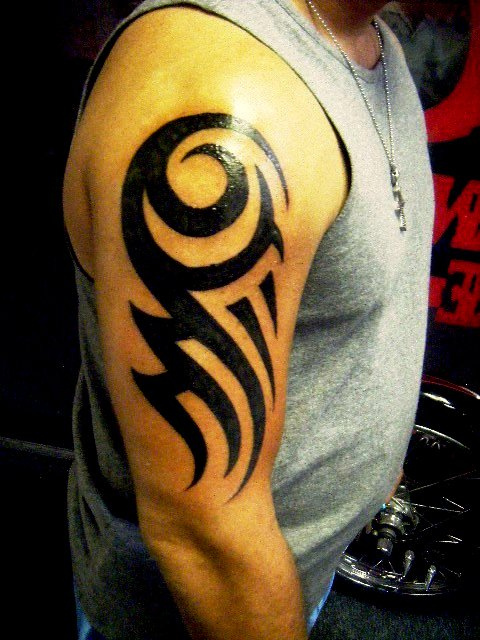 Dragon directory tribal tattoo style for Tribal bicep tattoos
