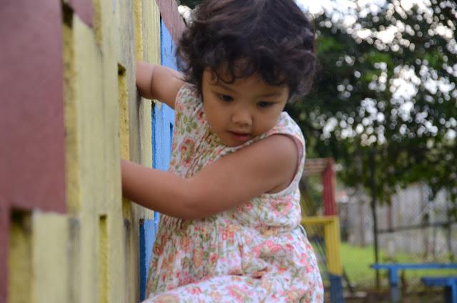 Kecil climbing the wall