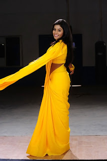Poorna New Pictures in Yellow saree 004.jpg