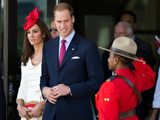 William and Kate, the Duke and Duchess of Cambridge, are saluted by an RCMP officer as they leave a citizenship ceremony on Friday, July 1, 2011, in Gatineau, Canada.