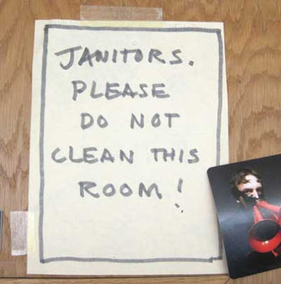 Handwritten sign reading Janitors - please do not clean this room