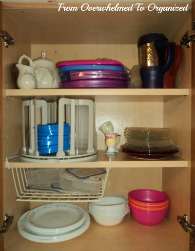 This Cabinet Had Our Plates And Bowls As Well Some Frequently Used Leftover Containers Tea Pot Travel Mugs A Few Other Miscellaneous Items