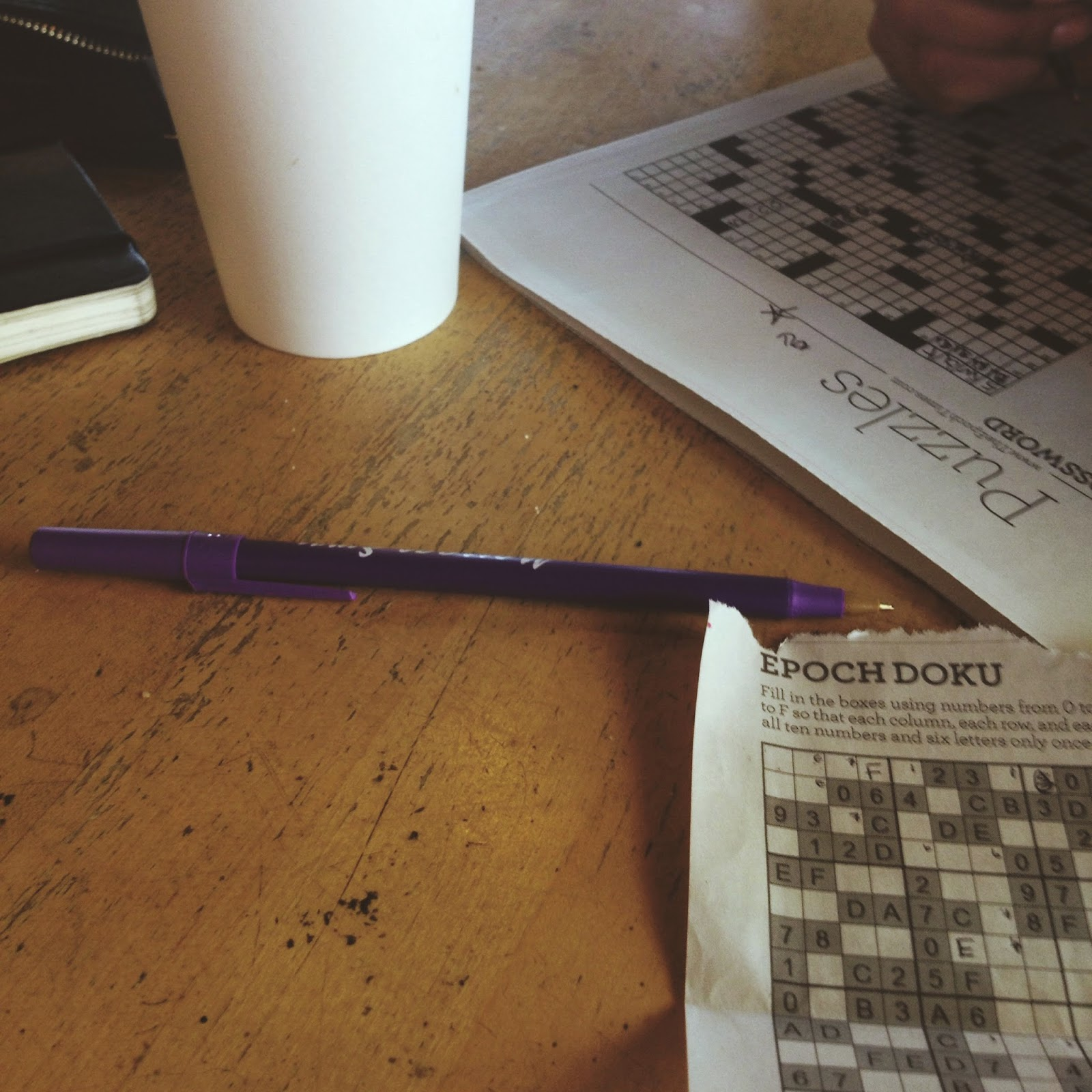crossword puzzle and sudoku at coffee shop