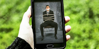 smartphone screen man tied picture