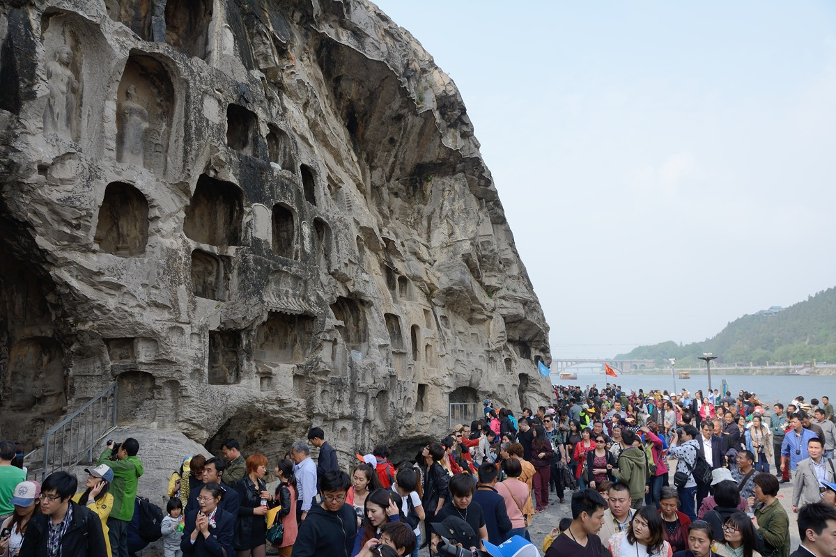 Niches and crowds at Longmen Grottoes