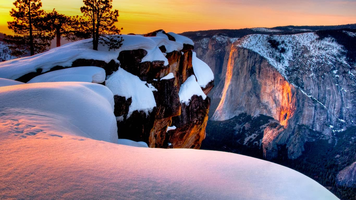 Horsetail Fall at sunset seen from Taft Point, Yosemite National Park, California (© Josh Miller/Aurora Photos) 324
