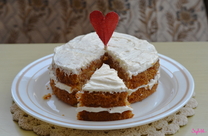 A carrot cake layered with Philadelphia cream cheese frosting with a heart shaped glitter topper is the perfect Do-it-yourself present that you can bake for Valentines Day