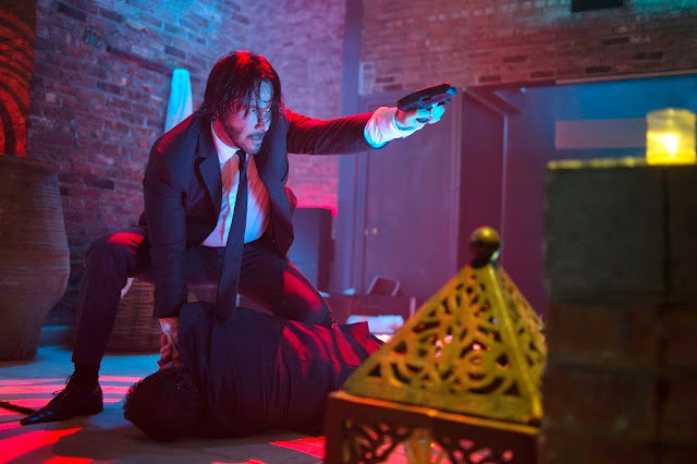 John Wick club scene movie still Keanu Reeves