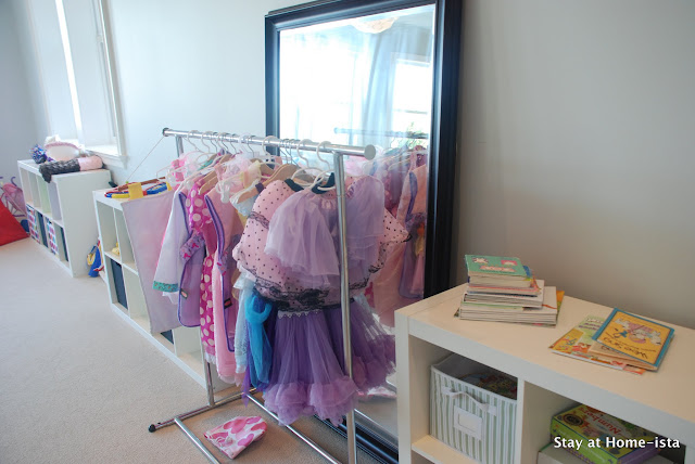 dress up clothes hung on a rolling rack for storage