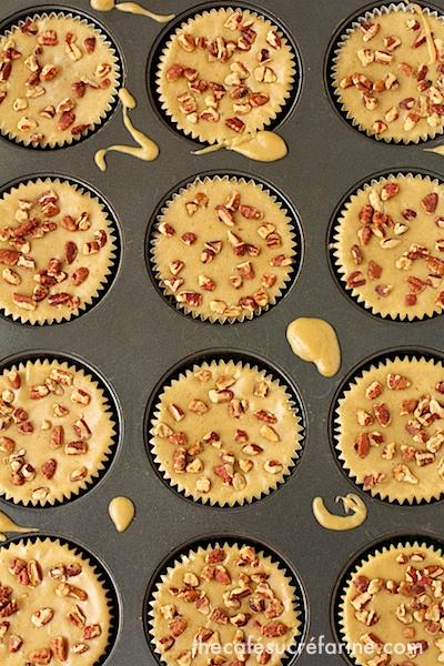 A photo of a cupcake baking pan of Brown Sugar Biscoff Sheet Cake Cupcakes.