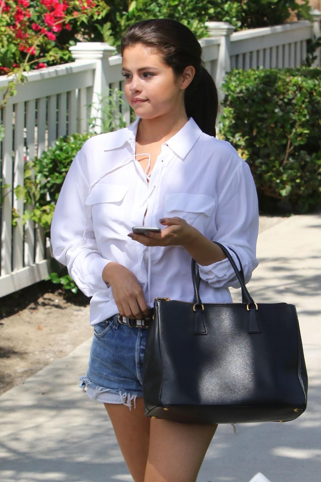 Selena Gomez flaunts legs in denim shorts in LA
