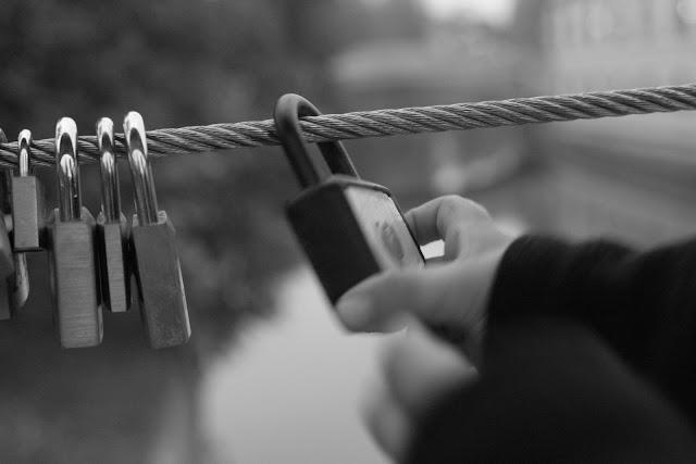 Anton playing with padlocks on Butchers' Bridge, Ljubljana.