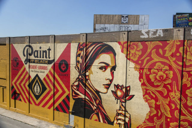 Shepard Fairey and his crew just finished working on a 147-feet long and 47-feet high mural on the streets of Jersey City in the USA.