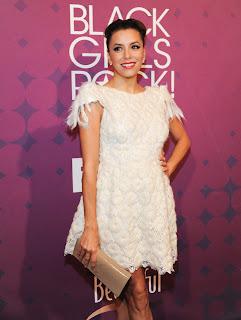 Eva Longoria wearing a short white dress