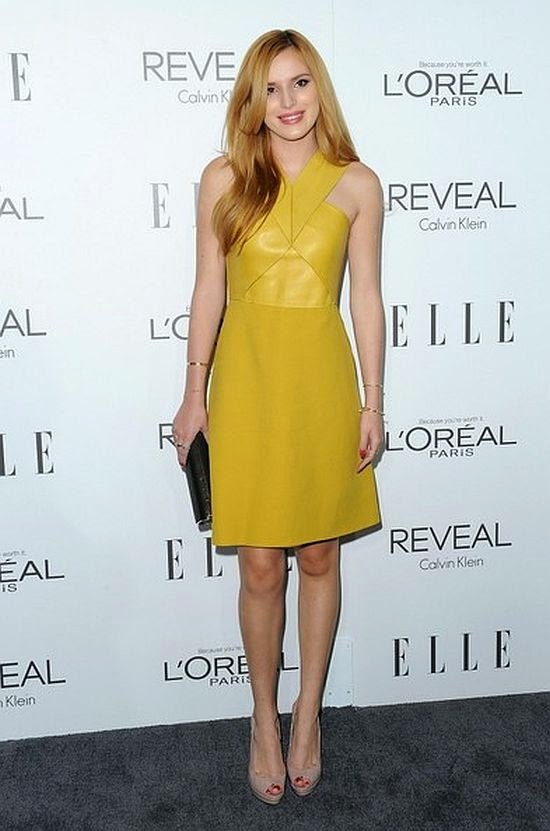 And not even the party, Bella Thorne was pictured wore a cute yellow dress as she attended the ELLE's 21st Annual Women at Four Season Hotel in Hollywood on Monday, October 20, 2014.