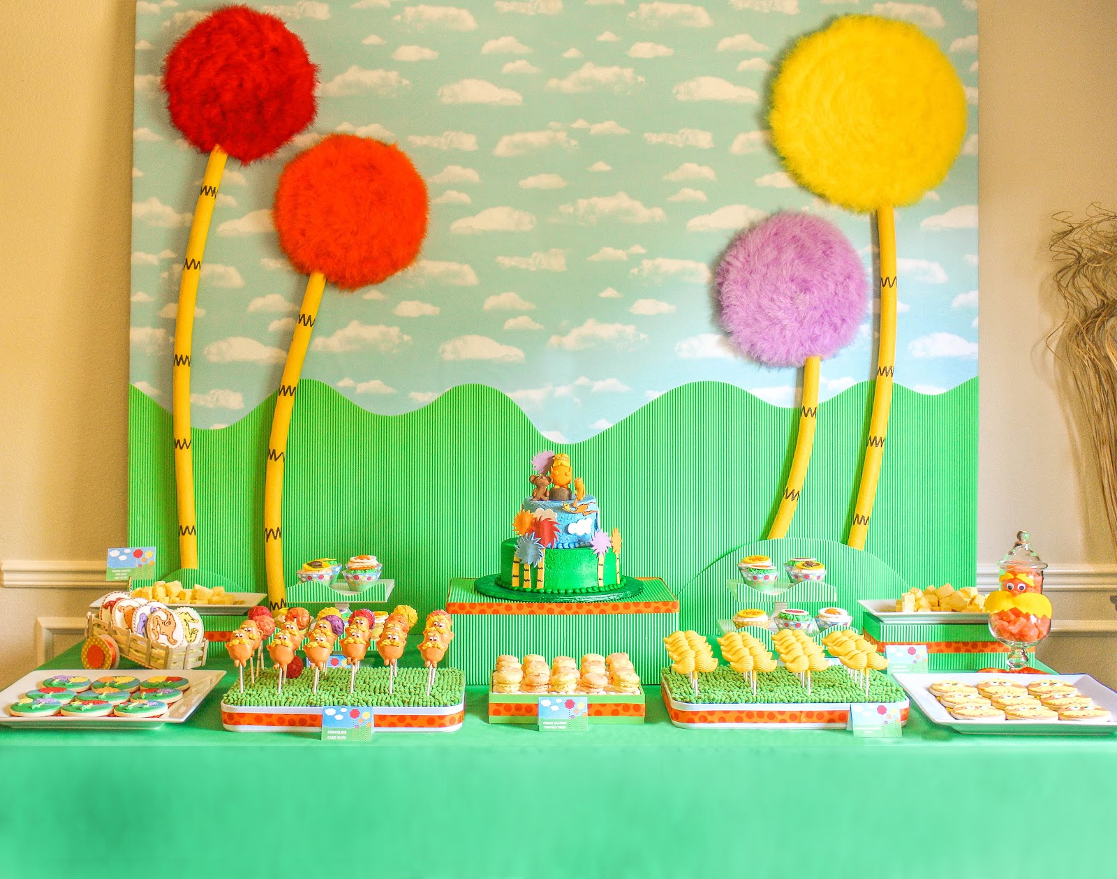 The party wall the lorax party part 2 decorations for Party backdrop ideas