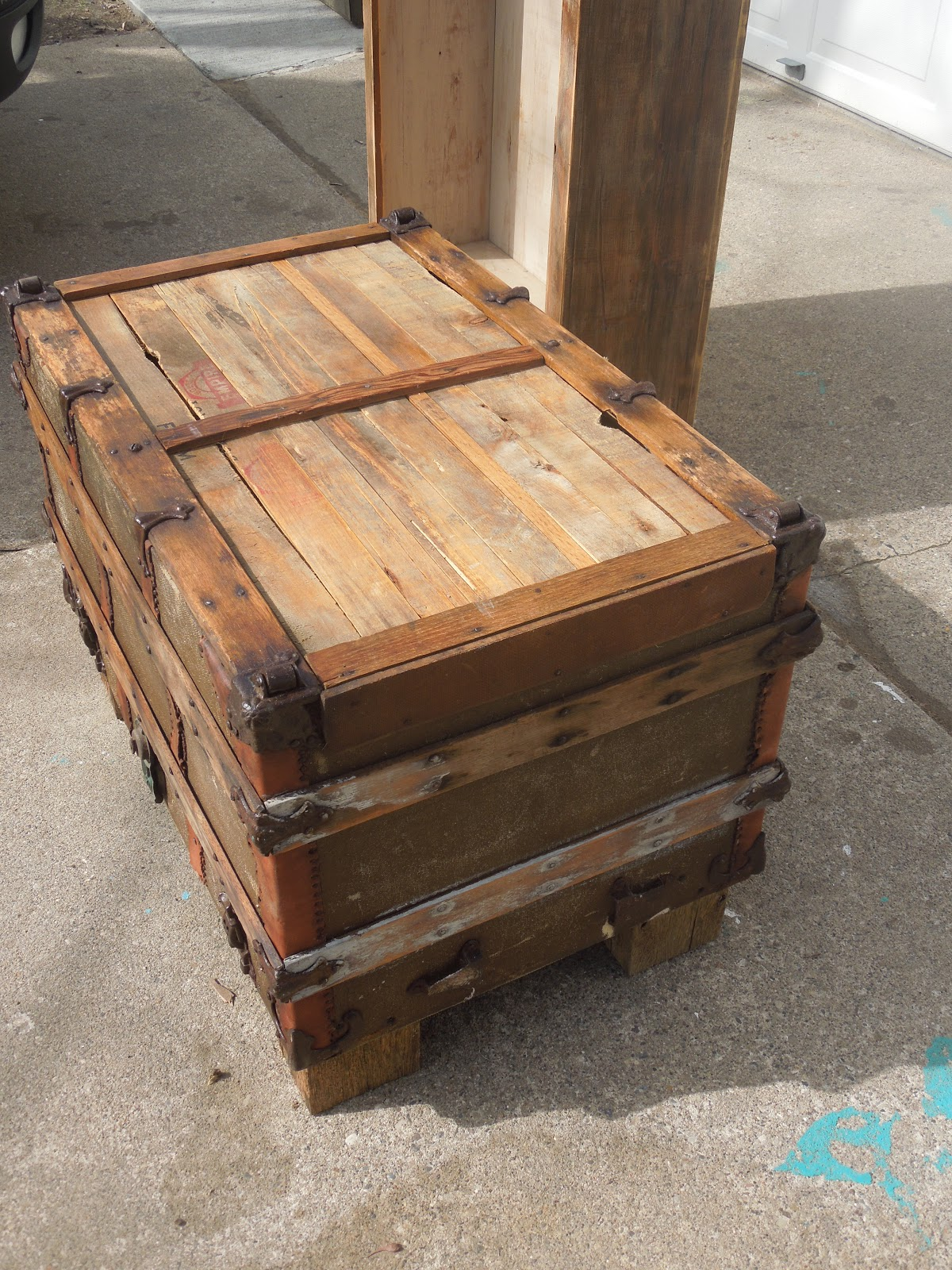 Tattered lantern old trunk coffee table sold Old trunks as coffee tables