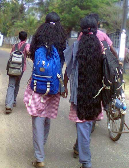 Kerala school girl with loose open long wet hair.