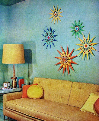 mid-century living room with blue wall and sunbursts