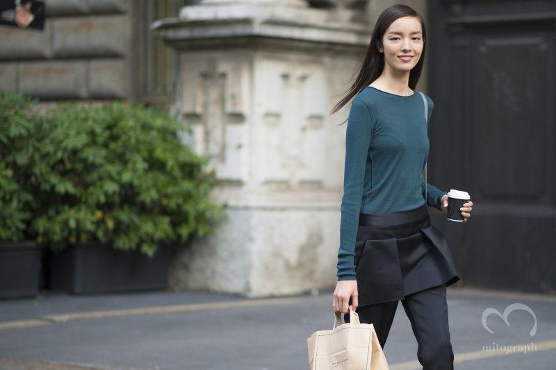 Model Fei Fei Sun leaves Jil Sander show during Milan Fashion Week 2015 Spring Summer MFW
