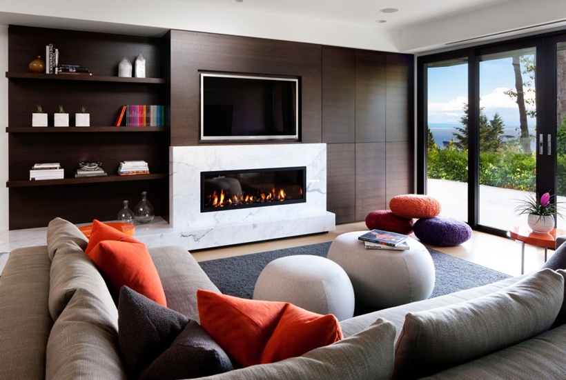 Entertainment room fireplace in Elegant modern house in west Vancouver, Canada